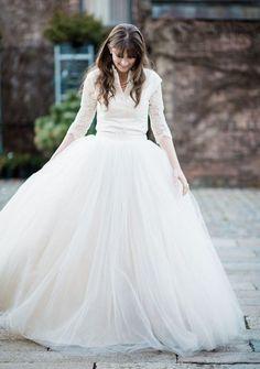 Stunning white long-sleeve ballgown wedding dress with tulle skirt; Featured Photographer: Kate Ignatowski
