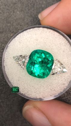 LOOK WHAT I HAVE HERE 🤔A gorgeous Loose 4.05-carat cushion cut Colombian emerald set aside large 1.10tcw trillion diamonds. Any thoughts about this? What are your favorite diamond accents for an emerald? 💚 #emeraldring #emerald #emeralds #emeraldcut #finejewellery #jewelrylovers #jewelryaddiction #jewelryinspiration #gemstones #bespokejewellery #ringgoals #showmeyourrings #gemology #alternativeengagementring #alternativebridal #gemstonejewelry #highjewelry #colombianemerald #looseemerald Resin Jewelry, Body Jewelry, Antique Jewelry, Vintage Jewelry, Cushion Cut Diamonds, Emerald Cut Diamonds, Emerald Jewelry, Gemstone Jewelry, Necklace Set