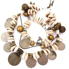 Beautiful assemblage necklace. A mixture of shells, vintage coins and findings <3