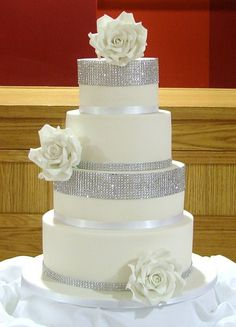 Close-Up of Diamonte & White Roses Wedding Cake by RubyteaCakes, via Flickr
