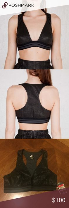 NWT NIKE Black Leather Sports Bra Sz L Guaranteed Authentic. Org retail: $230. Style: 483890. New, never worn; comes with tags. Racerback design, with perforated leather. Side zip. 100% lamb leather; 100% polyester lining. NO TRADES. Open to offers through the offer button ☺ Nike Tops