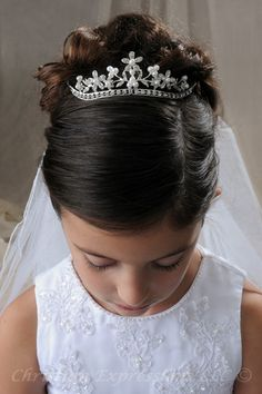 first communion veils in stock in a variety of styles including headbands, tiaras, crowns, bunwraps, wreaths. coordinate your communion veil with christian expressions first communion dresses and accessories. First Communion Veils, Girls Communion Dresses, First Communion Party, First Holy Communion, Communion Shoes, Bridal Veils And Headpieces, Headpiece Wedding, Wedding Veils, Communion Hairstyles