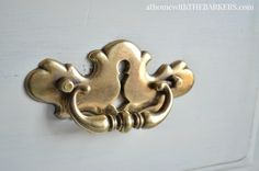 Cleaning brass hardware with vinegar is super easy way to restore furniture hardware