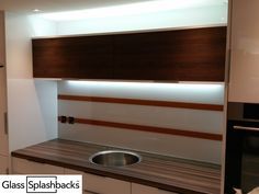 Brown stripe splashback. Have you ever considered designing your own splashback from start to finish? This modern look was achieved by sandblasting two sleek stripes into the glass, then using a contrasting colour. If you are a bit creative, and want something that is totally unique, why not contact us by clicking the link below? Our creative team will work with you to create a design completely to your specification. http://glasssplashbacks.com/index.php/711-2/