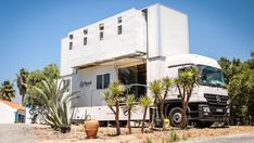 Double-decker motorhome chases the surf, and you sleep on the beach.