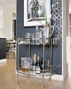 Deco inspired bar cart. Love all the mirror and shiny surfaces with the charcoal