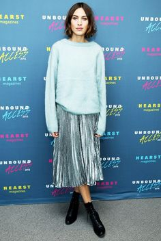 Follow Alexa Chung's lead and pair a pastel knit with your metallic pleated skirt.