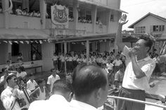 PRIME MINISTER LEE KUAN YEW WAVING TO students at the Serangoon Gardens North or South School in 1963.
