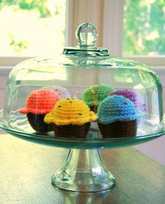 These Bake Me a Cake Crocheted Cupcakes are completely adorable! Set these out under a glass cake plate as placeholders between baking days, then simply replace when you have fresh baked goods to display.