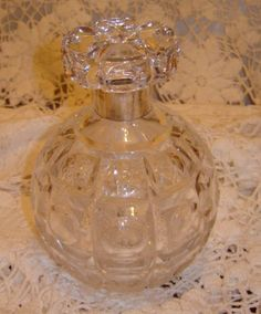 impressive piece of glass. It is Extremely heavy, standing over 6 inches high with a hallmarked silver collar about 1 inch wide.