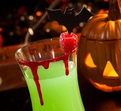 Cocktail idea for your Halloween party: Bloody rims. Although raspberry jam or sauce will work okay for this, consider the impact of this high-end effect, which can also be prepared ahead of time. See the full recipe at http://sparklerparties.com/halloween/memorable-halloween-cocktails/
