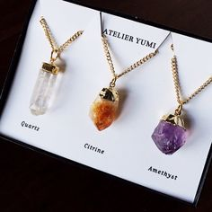 Set of THREE raw crystal pendant necklaces. The perfect gift set! A beautiful set of three gemstone crystal necklaces. Clear quartz, purple