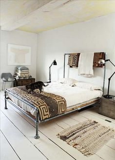 bed frame made of salvaged pipes: color palette, materials, rug