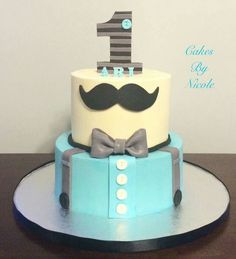 Nicole Peterson, Cakes by Nicole:  1st birthday cake.  Little man.  Mustache.  Suspenders.  Bow tie.