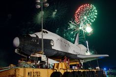 Fireworks celebrate the June 2012 arrival of Houston's full-size space shuttle mockup, which Space Center Houston's contest will now name. [See More Images]