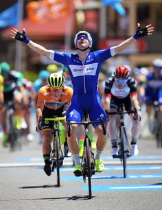 Elia Viviani of Italy and QuickStep Floors crosses the finish line ahead of Caleb Ewan of Australia and MitcheltonScott during stage three of the...
