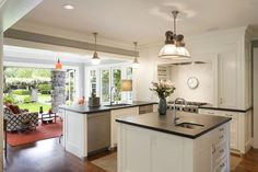 The kitchen and sun room open out to the lovely garden space making it a perfect place for summer entertaining. Description from onekindesign.com. I searched for this on bing.com/images