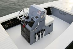 Standard console allows for flush mount electronics and has a lockable, bi- fold acrylic door that is removable for easy access into the console. Note the trim tab switch landing offering trim tab operation without leaving the throttle.