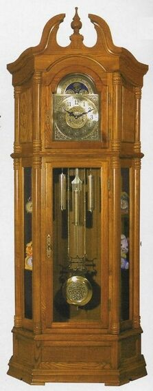 """Light oak finish wood grandfather clock with side curio cabinets , some assembly required, does require you to wind the clock each month, pendulum does swing with the seconds. Doors open up to the pendulum and the face of the clock, measures 27"""" x 11"""" x 84"""" H SKU ACM01410"""