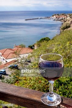 Glass of Greek red wine and view of Molyvos Harbour, Lesvos,... #mithimna: Glass of Greek red wine and view of Molyvos Harbour,… #mithimna