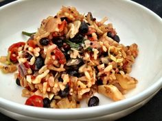 throw it all in dinner: sauteed onion, cherry tomatoes, garlic, black beans, red pepper, cabbage, brown rice, quinoa, and a little parmesan cheese
