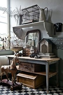 I love this display! What a great table - with an awesome collection of vintage treasures. The moulding is breathtaking, too!
