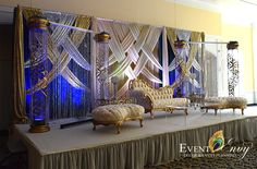 Royal blue, ivory, and gold crystal themed wedding stage. #weddingbackdrop #weddingstage #foxchasemanor #afghanwedding #receptiondecor #dmvweddingdecorators