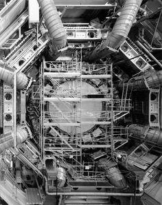 STAR GATES: Stanley Greenberg-TIME MACHINE?? Greenberg's travels led him inside mountains, into mine shafts, as well as into laboratories miles above sea level. The results are breathtaking photographs in which hulking detectors and accelerators are revealed to be structurally interesting objets. Through his work Greenberg takes readers deep into the world of muons, neutrinos, and quarks, a place where scientists mount ever-larger experiments in hopes of finding ever.birds-eye view of…