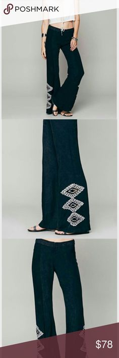 """Free People black POP PIER EMBROIDERED FLARE pants POP PIER EMBROIDERED FLARE   Embroidered soft trousers with mesh inserts along the hem. Flared silhouette with hidden zip fly.   *By Tallow x Free People    *100% Rayon  *Machine Wash Cold  *Import  Approximate Measurements for Medium: Waist: 32"""" Hips: 38"""" Rise: 10.5""""   Inseam: 30 1/2"""" Size XS = US 2  Size S = US 4  Size M = US 6  Size L = US 8  Size XL = US 10   BRAND NEW W/O TAGS Free People Pants Boot Cut & Flare"""