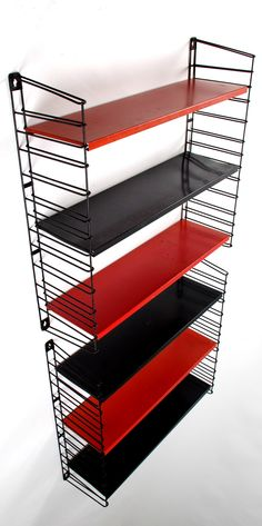 Tomado, Holland, wall shelves in painted metal, adjustable system with black end caps and removable metal shelves in red and black. Wall Shelving Units, Metal Shelves, Display Shelves, Wall Shelves, Industrial Style, Industrial Design, Free Standing Shelves, Painted Metal, Paint Schemes