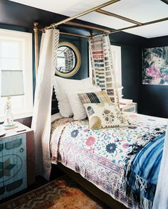 A brass canopy bed dressed with floral linens  Details: Gold Vintage Furniture, Black-Multicolored Bohemian-Vintage Bedroom  Keywords: Brass Bed, John Dransfield & Geoffrey Ross, Colorful Bedroom, Canopy Bed, June July 2012 Issue, Bedroom Ideas, Decorative Pillows, Bedding  (Source: Lonny)
