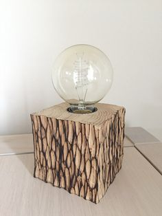 """Phyto"" Lamp to ask wooden with filament bulb, finishing gouge smoked, very original. Dimensions (cm): L 10 X w 10 X H 10 Wood Lamp Base, Wooden Floor Lamps, Wooden Lamp, Rustic Log Furniture, Driftwood Lamp, Wood Wall Shelf, Retro Lighting, Diy Home Decor Projects, Industrial Interiors"