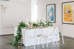 Love this tablescape with ferns, poppies and vintage light bulbs!