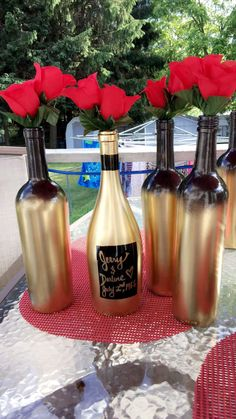 Black and gold ombre, spray painted wine bottles.  These were used as cake table decorations for a 50th anniversary party. Would also make nice centerpieces.  Quick and easy to make!  Make sure you coat the wine bottles with rubbing alcohol before painting.