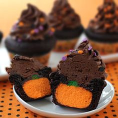 We would need to do another shape but these look yummy!  The ultimate chocolate cupcake stuffed with a CHEESECAKE pumpkin.