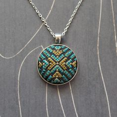 North Star Cross stitch pendant necklace Emerald por TheWerkShoppe