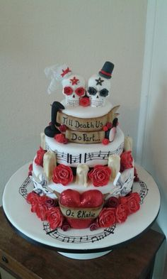 Double sided skull wedding cake by Petticoats & Frills Cakes