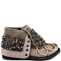 Biker chic never looked better with this bad design from Zigi Girl. Declare showcases encrusted studs & gems on the folded cuff and tongue of this rockin' grey bootie. The rounded toe and 1 1/2 inch heel keep you ready to ride anytime the open road calls to you.