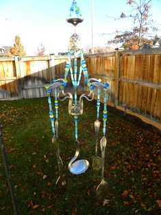 Wind chime art with assorted whimsical silver pieces - funky garden art - pastel blue, green and purple glass beads - bent spoons - egg cup