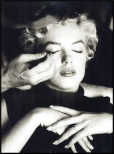 Marilyn was an artist with her make up. Here she is taking a break while her make up artist Whitey Snyder dolls her up.