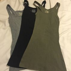 Bundle of tank tops Three tank tops from Mossimo Long and Lean collection.  All size small.  One black, one grey, one green.  take 20% off bundles of 2 or more ask about discounted shipping Mossimo Supply Co Tops Tank Tops