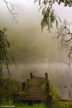 an old wooden bridge....going out to...Loch Ard, Trossachs, Scotland