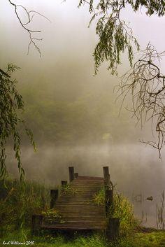 an old wooden bridge....going out to...Loch Ard, Trossachs, Scotland