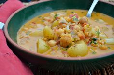 Curried Coconut Soup with Chickpeas and Cauliflower - Substituted Curry for Gr. Masala, used chicken broth, sweet potato, topped with squeeze lemon.