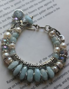 so breathtaking, with two strands, one of lovely large pearls, to crystal spacers, faceted ab treated light blue crystals, studded silver beads,