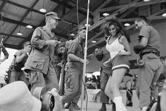 Raquel Welch dances on stage with a group of soldiers in Da Nang Vietnam - early 1970s