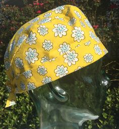 "Print: Yellow Daisy   COLORS: Yellow and Light Blue  Size: Adjustable Small to Medium   Pixie Style Cap     Options for ties:   • Ribbon ties: ribbon is either 7/8"" or 5/8"" depending on which colors I use. The ribbon will be a patterned or solid grosgrain and the patterns will vary so each scrub cap is unique!  • Fabric ties: the fabric ties will match either the scrub cap liner or the main color of the cap  • Boutique Bow: This is a handmade bow that is secured to the back of the scrub cap…"