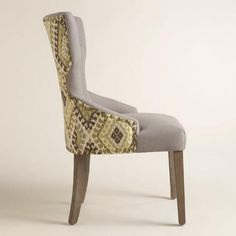 With a curvy keyhole silhouette and a pop of bold color, our dining chair brings bright style to the table. Upholstered with gray tufted linen on one side and a green woven geometric print on the back, it's framed with nail heads for a classic touch. Bar Stool Chairs, Cool Chairs, Dining Chairs, Dining Room, Swivel Rocker Recliner Chair, Upholstered Swivel Chairs, Small Workspace, Navy Blue Living Room, Chair Drawing