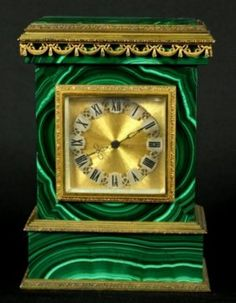 ORMOLU AND MALACHITE CLOCK ON SILVER