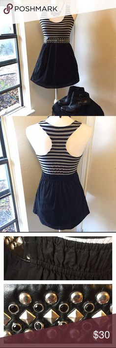 Belle Du Jour Dress w/ Pockets + Studded Belt This trendy dress features silver square and circle studs along with black gems on the built-in faux leather waist. There are invisible pockets on each hip and the back of the waist is an elastic band. The skirt is double-lined. The stripes are black and grey. This is ultra flattering and would look great with heels and a jacket. * Great Condition, Gently Worn* Belle Du Jour Dresses